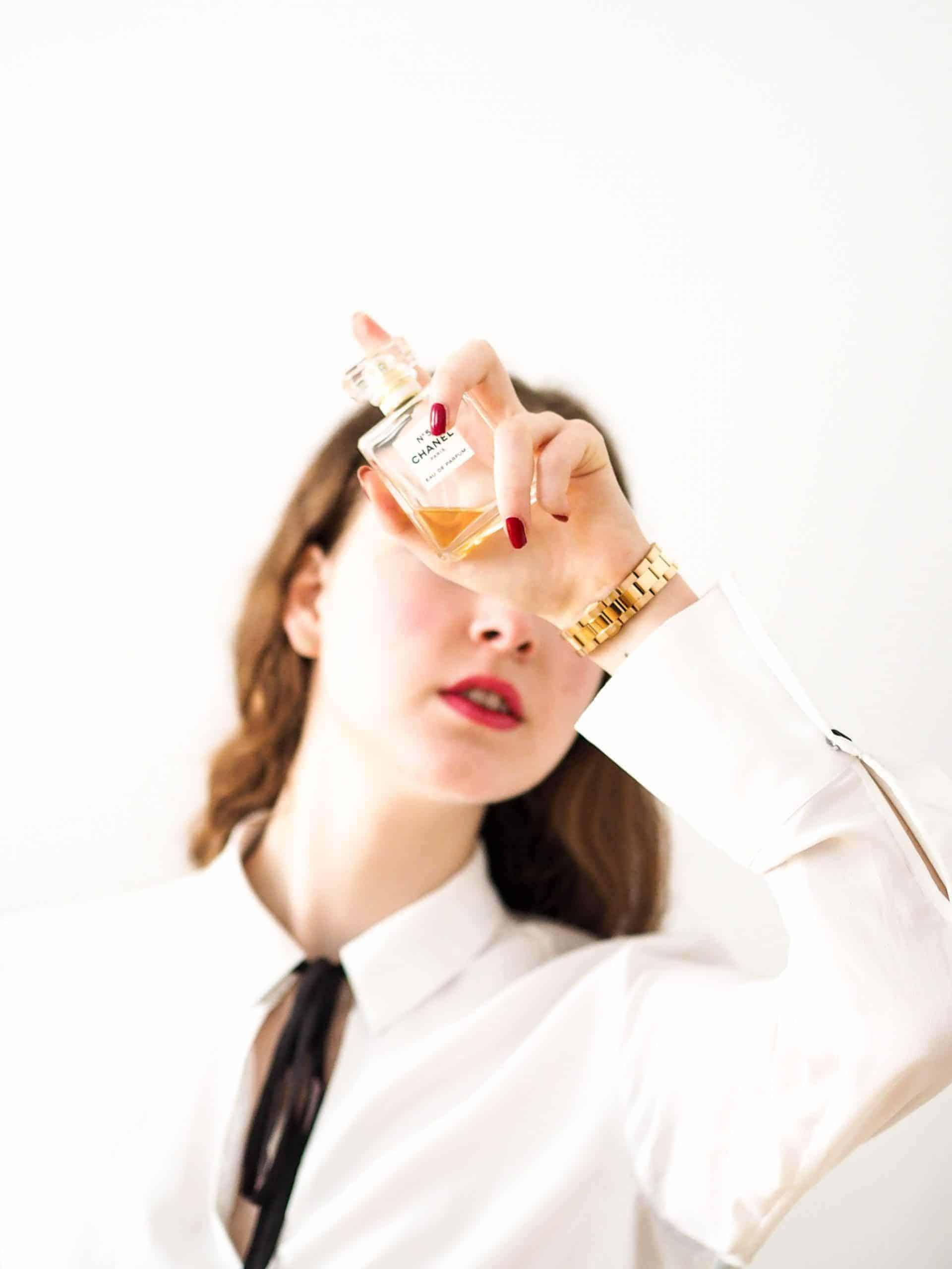 Woman holding Coco Chanel Perfume